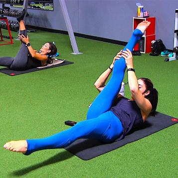 Instructor teaching a pilates class