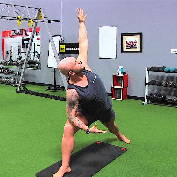 Instructor teaching a yoga class