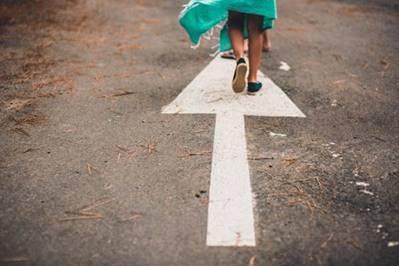 walking on arrow on road